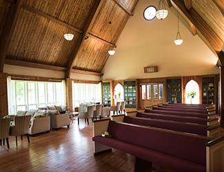 Inside chapel with chairs and pews