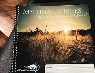 Book on table that says My final wishes. Preplanning for funeral and burial